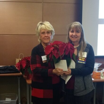 Carol, on the left, receives recognition for her 50 years as an Academy member.